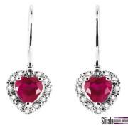 bliss: orecchini in oro bianco con rubini a forma di cuore. Prezzo al pubblico 595,00 euro.