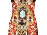 PHILIPP PLEIN 04_Minidress con stampa caleidoscopica all over sui toni del rosso del nero e dell'oro, in jersey di seta a maniche corte. Prezzo indicativo al pubblico: € 600,00