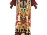 PHILIPP PLEIN 03_ Long dress con stampa caleidoscopica all over sui toni del rosso, dell'arancio e dell'oro, in seta con profonda scolatura sul decolleté e sulla schiena. Prezzo indicativo al pubblico: € 2.700,00
