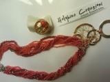 Collana Ruota della Fortuna ( cristalli misure varie tonalità del rosso cangiante). Ruote della Fortuna sempre con te !