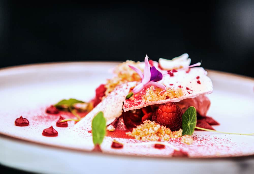 Modern food stylist decorating meal for presentation in restaurant. Closeup of food stylish. Restaurant serving Di Ivan
