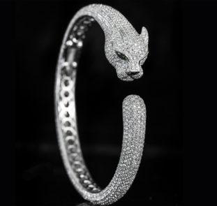 Bracciale di Cartier con testa di Pantera tempestato di diamanti